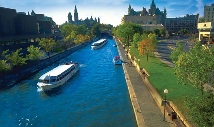 Boats Floating Down Rideau Canal in Ottawa, Canada